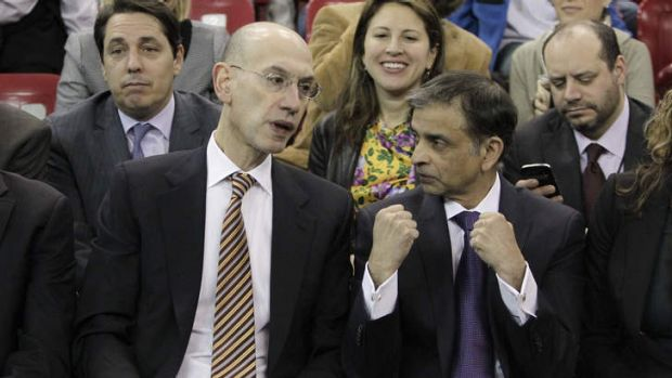 Adam Silver, the new NBA Commissioner, talks with Sacramento Kings majority owner Vivek Ranadive as the Kings play the ...