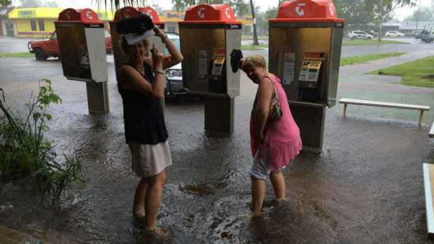 Kununurra locals make the most of the torrential downpour.