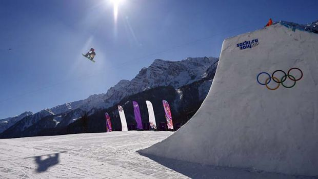 Britain's Billy Morgan clears a jump during the men's snowboard slopestyle final.