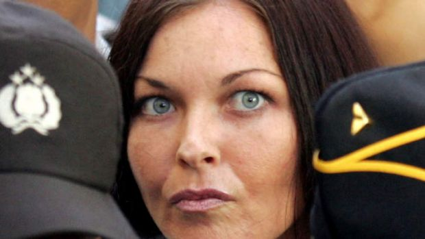 Australian Schapelle Corby is escorted by police after she arrived at a Denpasar court on Bali July 20, 2005.