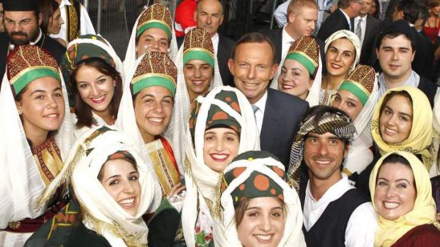 Prime Minister Tony Abbott with greek dancers at the Antipodes Festival on Lonsdale Street.