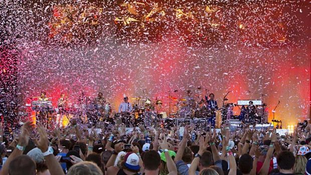 Out with a bang: Confetti covers the crowd as Arcade Fire help to close out this year's Big Day Out festival in Sydney.