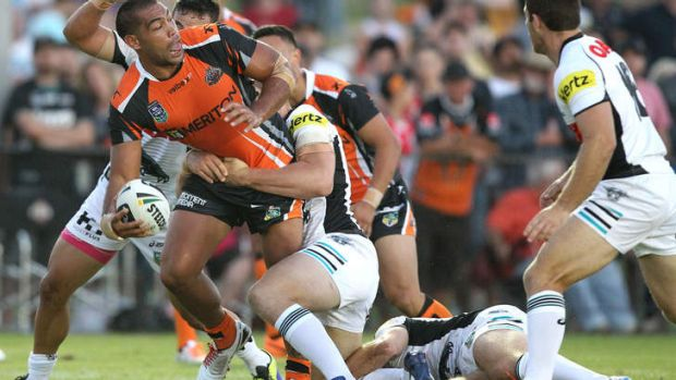 Stand and deliver: Wests Tigers powerhouse Adam Blair looks to offload in the trial against Penrith, won easily by the ...