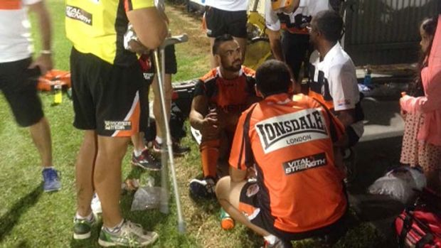 Dene Halatau receives attention at the side of the pitch.