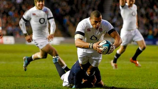 Try time: England's Luther Burrell scores a try as Scotland's Greig Laidlaw attempts a tackle during their Six Nations ...