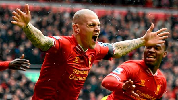 On fire: Martin Skrtel of Liverpool celebrates scoring the opening goal against EPL leaders Arsenal in the opening ...