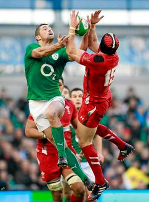 Big men fly: Ireland's Rob Kearney and Wales' Leigh Halfpenny clash for the ball during their Six Nations match.