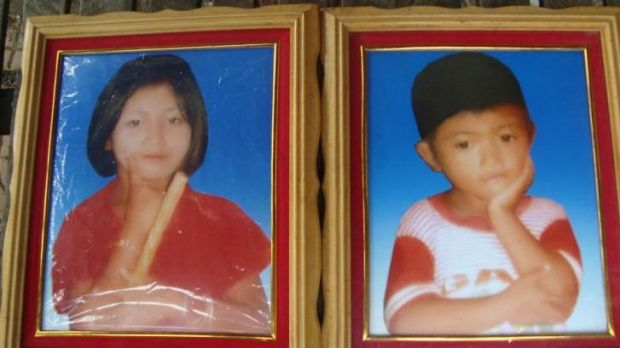 Looking for water: Hut Heap, 13, and her brother Hut Hoeub, 9, drowned in a pond in the Battambang resettlement camp.