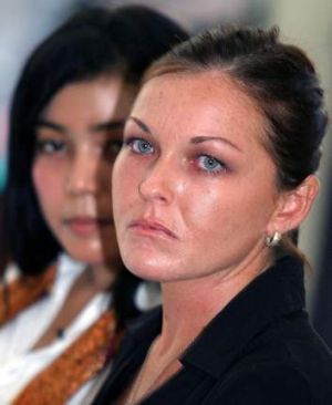 Schapelle Corby sits with her translator during her trial in a Denpasar court on the Indonesian resort island of Bali ...