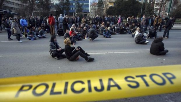 Protesters block traffic in front of a government building in Sarajevo.