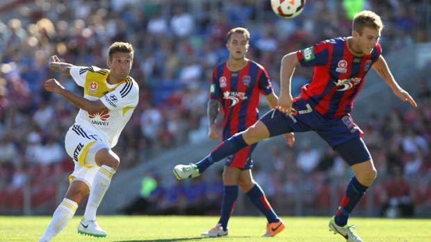 The Wellington Phoenix's Vince Lia shoots against the Newcastle Jets.