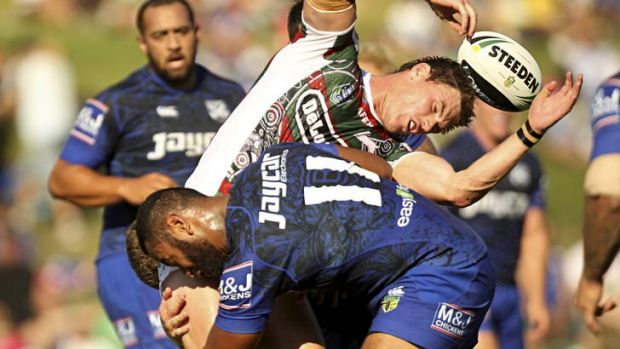 Bruising: Souths Joe Picker is crunched by the Bulldogs defence.