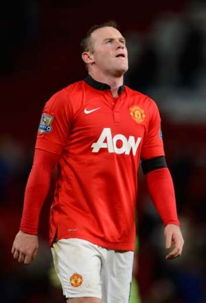 Wayne Rooney looks dejected upon hearing the final whistle.