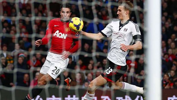 Fulham's Dan Burn (R) appears to handle the ball in the penalty box after a header on goal from Manchester United's ...