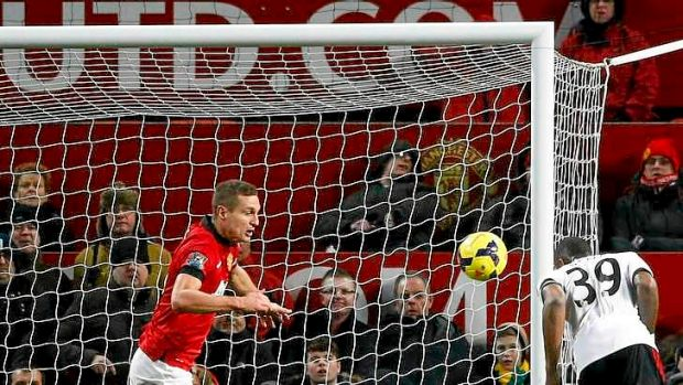 Fulham time: Darren Bent stoops to head home the equaliser deep into what used to be known as Fergie time at Manchester ...