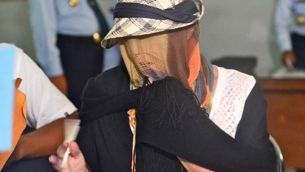 Out of jail: Schapelle Corby covered her face when she was released.