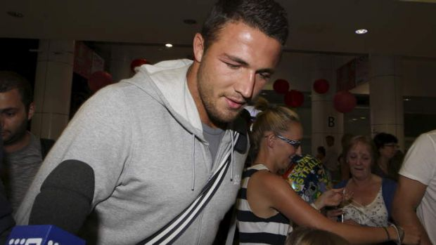 No comment: Sam Burgess hurries through the terminal.