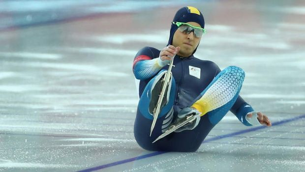 Stunned: Daniel Greig of Australia falls onto the ice at the start of his heat during the Men's 500m Speed Skating event.