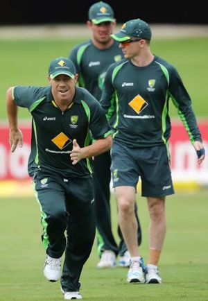 David Warner (L) runs during an Australian nets session at Centurion Park.