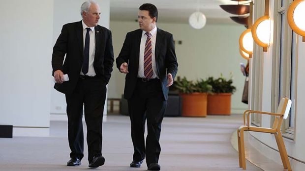 Senators John Madigan and Nick Xenophon have senators threatened to dump the plates, tea cups and saucers at the Prime ...