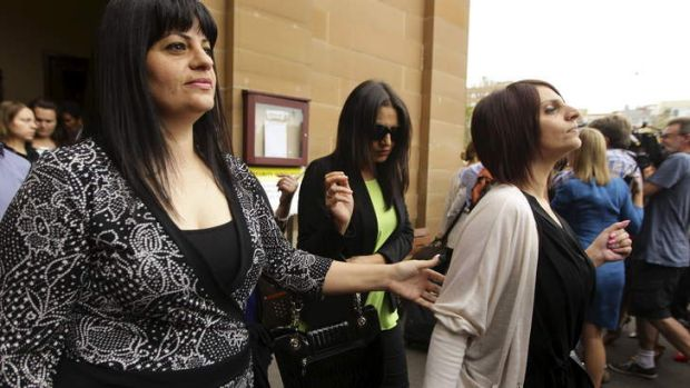 The sisters of Simon Gittany leave court after seeing their brother jailed for at least 18 years.