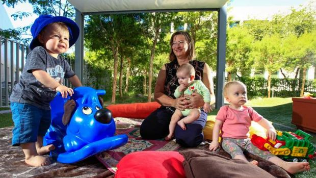 Dr Julie Smith with Allanah Gordon, four months, and, left, Vincent Swadling, 18 months, and, right, Bryn Williams, 18 ...