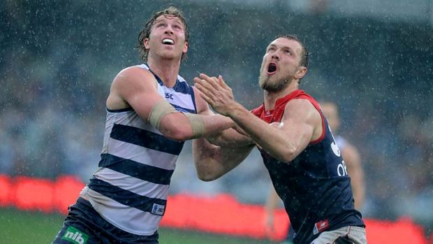 Dawson Simpson battling in the ruck with Melbourne's Max Gawn last season.
