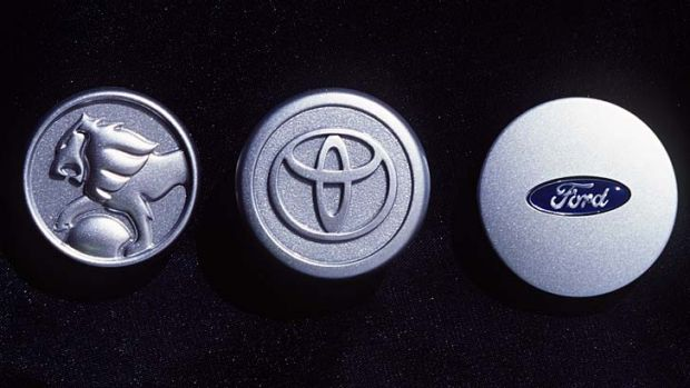 Badges of the final three car makers set to quit car manufacturing in Australia.