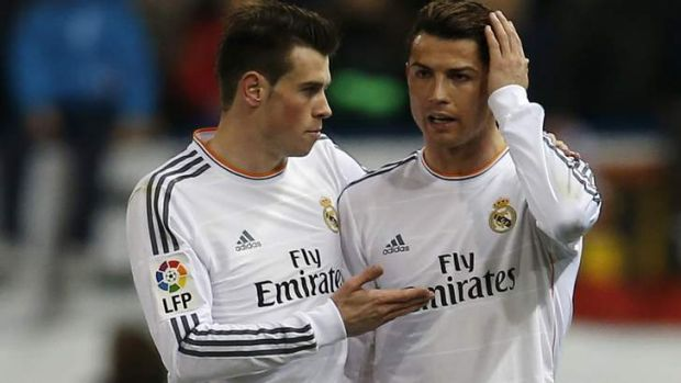 Cristiano Ronaldo is consoled by Gareth Bale after being struck by a lighter.