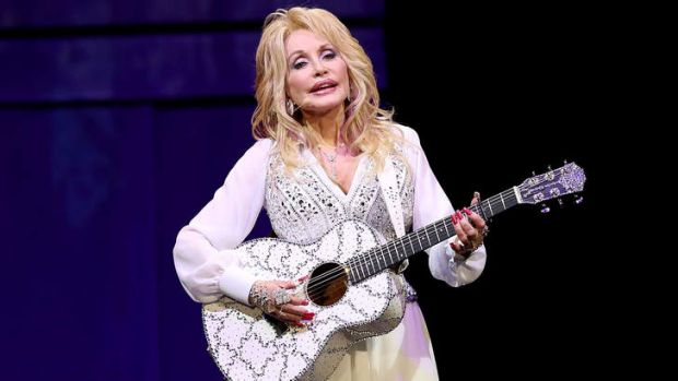 Dolly Parton performs at Melbourne's Rod Laver Arena on February 11, the first show of her <i>Blue Smoke</i> tour of ...