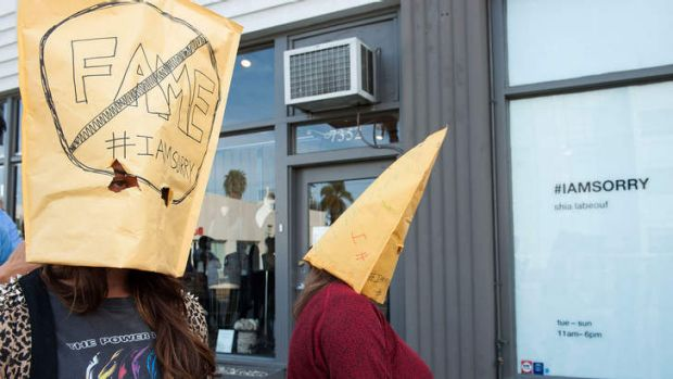 More paper bags: Out the front of the Cohen Gallery during Shia LaBeouf's <i>IAmSorry</i> art installation in Los ...