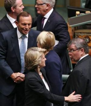 Prime Minister Tony Abbott shakes hands with Labor MP Jenny Macklin after delivering the Closing the Gap report.