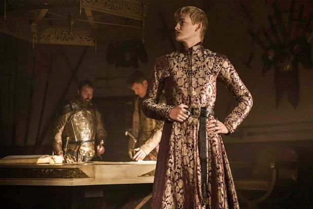 <i>Game of Thrones</i> season 4: King Joffrey Baratheon (foreground) with his father/uncle Jamie Lannister and another ...