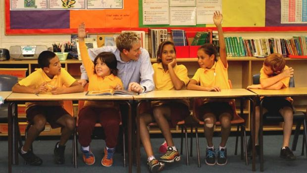 Where the three Rs also refers to relationships: Vice-principal Bryce Walker with students at Glebe Public School where ...