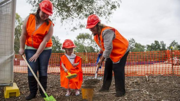 Adrielle Connors and daughter Amelia Connors, 3, and Minister Joy Burch at the first turn of the sod for Canberra ...