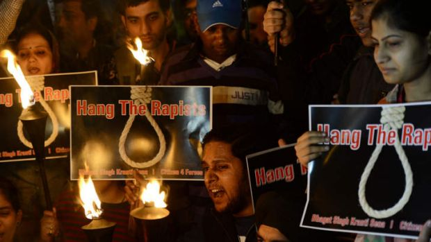 On December 19, 2012 Indian students and activists shout slogans as they carry torches at India Gate during a protest ...
