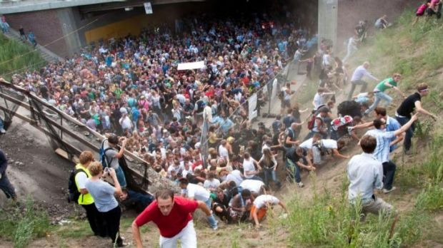 People flee during a mass panic  at a techno festival in Duisburg, Germany in 2010.