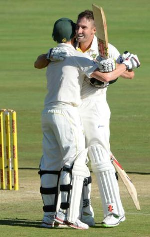 Steve Smith celebrates Shaun Marsh's century.
