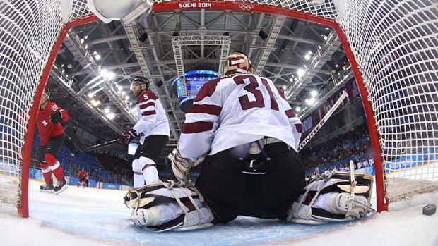 Nino Niederreiter of Switzerland scores the winning goal with seven seconds left in the third period against Latvia.
