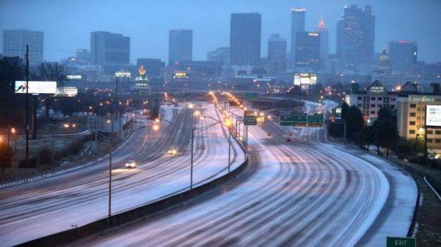 Sparse traffic makes its way on the highway just south of downtown Atlanta.
