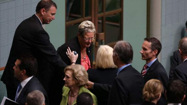 Members of Parliament greet Kaye Baird the mother of the late Corporal Cameron Baird MG VC and his brother Brendan.