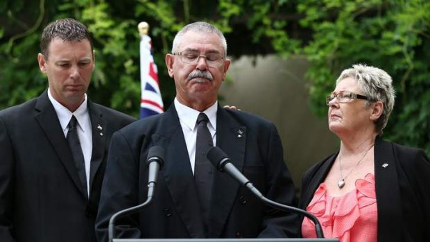 Corporal Baird's father Doug is comforted by his wife Kaye and son  Brendan as they family address the media.