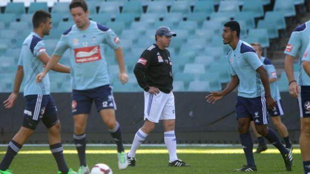 Business as usual: Frank Farina runs Sydney FC through drills at Allianz Stadium on Thursday.