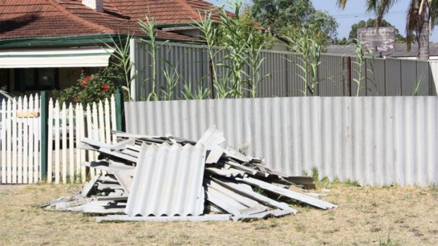 The asbestos was left on the verge for two months before the woman moved it back into her backyard.