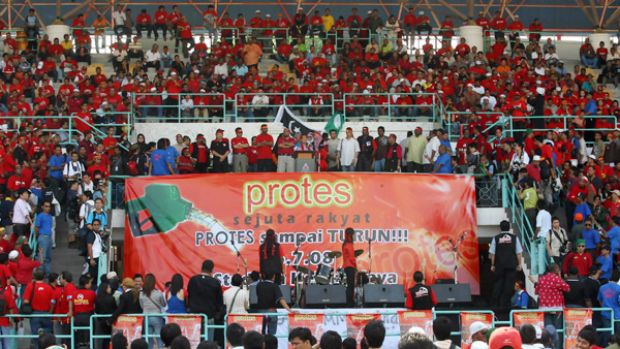 Against the odds: Despite police saying a rally was illegal and setting up roadblocks, Malaysian opposition supporters ...