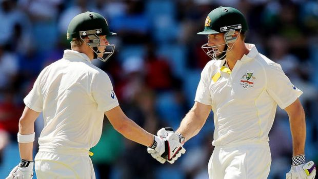 On song: Steve Smith and teammate Shaun Marsh during the first Test.