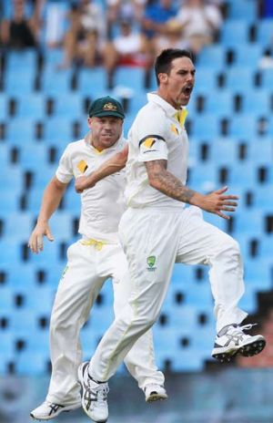 Australia's bowler Mitchell Johnson, right, with teammate David Warner, left, reacts after dismissing South Africa's ...