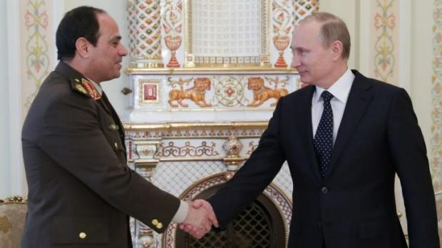 Russian President Vladimir Putin, right, shakes hands with Egypt's Military chief Field Marshal Abdel-Fattah al-Sisi.