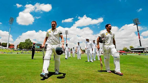 Australia's Ryan Harris and Mitchell Johnson wear black armbands in honour of Luke Batty on day two of the first Test ...