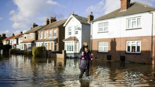 Under water: A street in Egham in Surrey, south-east England.